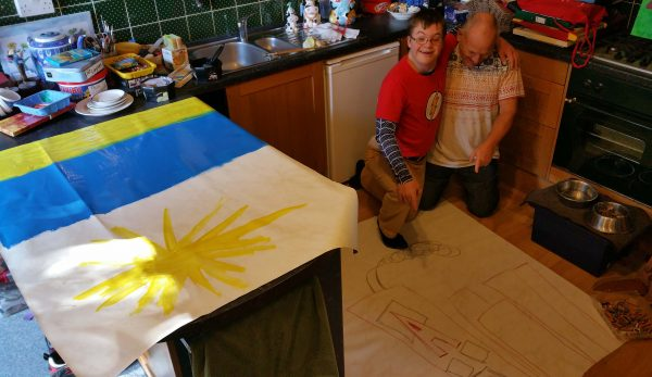 Superhero Charlie Lyne art at home with Chris Billington